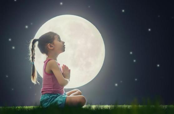 cute little child girl enjoying meditation and yoga on green grass on moon sky (1)